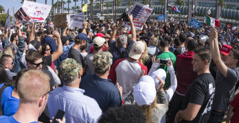 SAN DIEGO USA - MAY 27 2016: Trump supporters gather to confront a rather vulgar crowd of anti-Trump protesters after a Trump rally at the San Diego convention center.