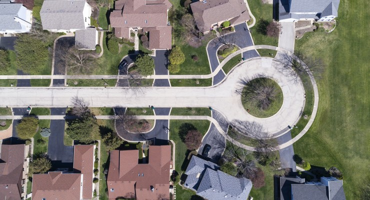 Aerial view of homes on a cul-de-sac in a suburban setting in th