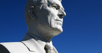 Bust of Ronald Reagan sculpture against blue sky in President's