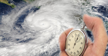 Hurricane Patricia and Hand Holding old Stopwatch. Concept of Climate change. Elements of this image furnished by NASA