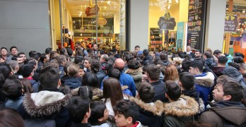 People Wait Outside A Department Store During Black Friday Shopp