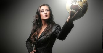 A beautiful woman with a big globe
