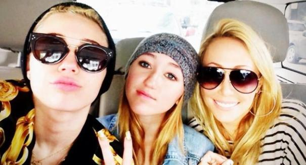 Miley Cyrus posts a photo of 'the baddest b—hes in the world'
