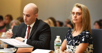 Defense Attorney Cory Madera makes notes as defendant Michelle Carter listens with attorney Joseph Cataldo (not shown) during her trial at Taunton Juvenile Court in Taunton, Mass., Monday, June 12, 2017. Carter is charged with involuntary manslaughter for encouraging Conrad Roy III to kill himself in July 2014. (Faith Ninivaggi/The Boston Herald via AP, Pool)