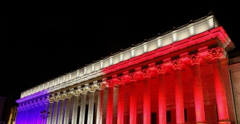 Lyon, France - July 15, 2016: French national colors on the courthouse called palais de justice in French in tribute to all victims of terror in Nice, France