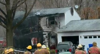 3 missing, at least 3 dead after small plane crashes into home