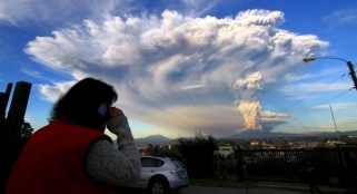 Spectacular plume of ash blasted from volcano in Chile, causing evacuations and flight cancellations